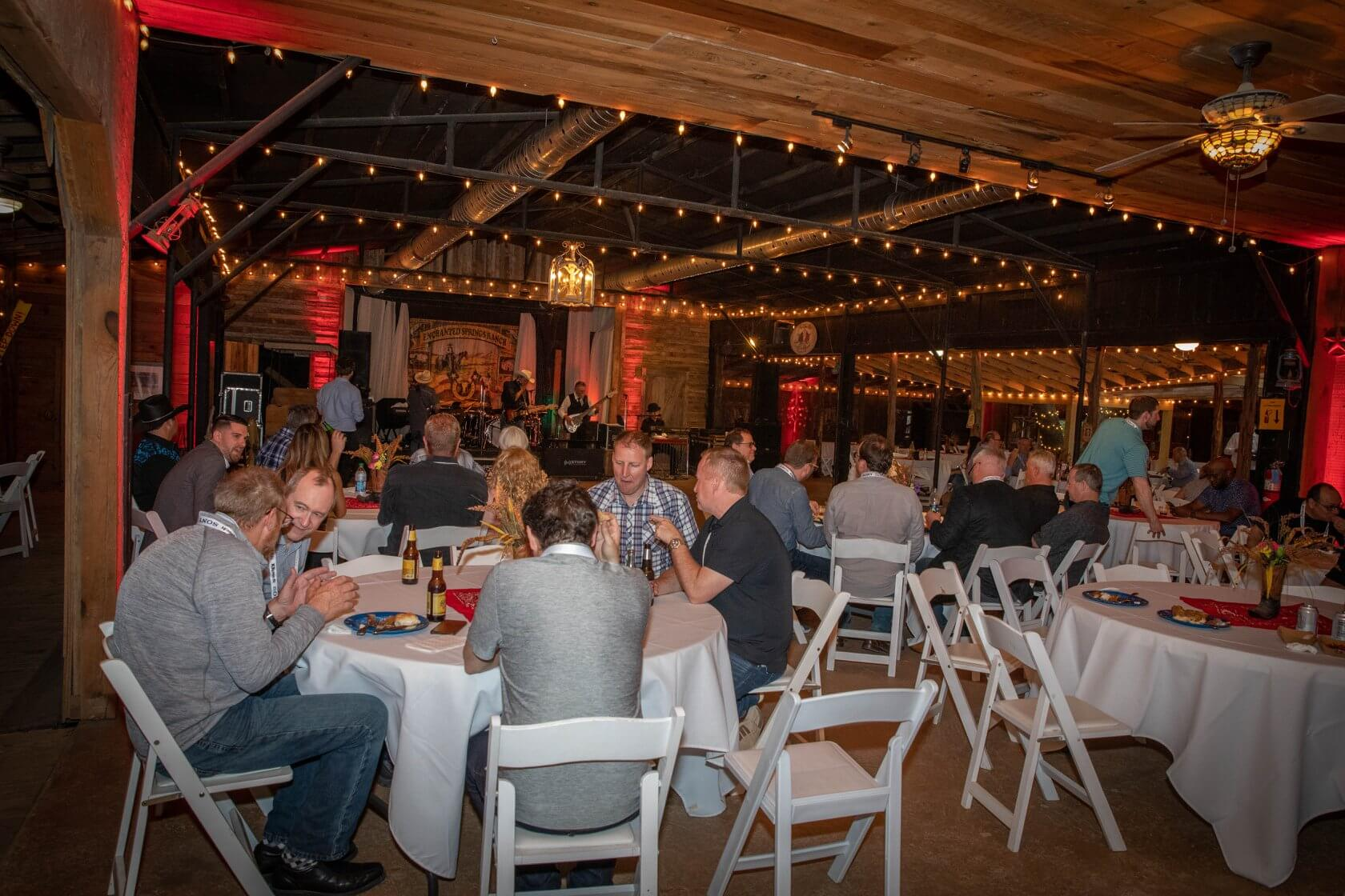 A corporate group enjoying a business dinner at Enchanted Springs Ranch