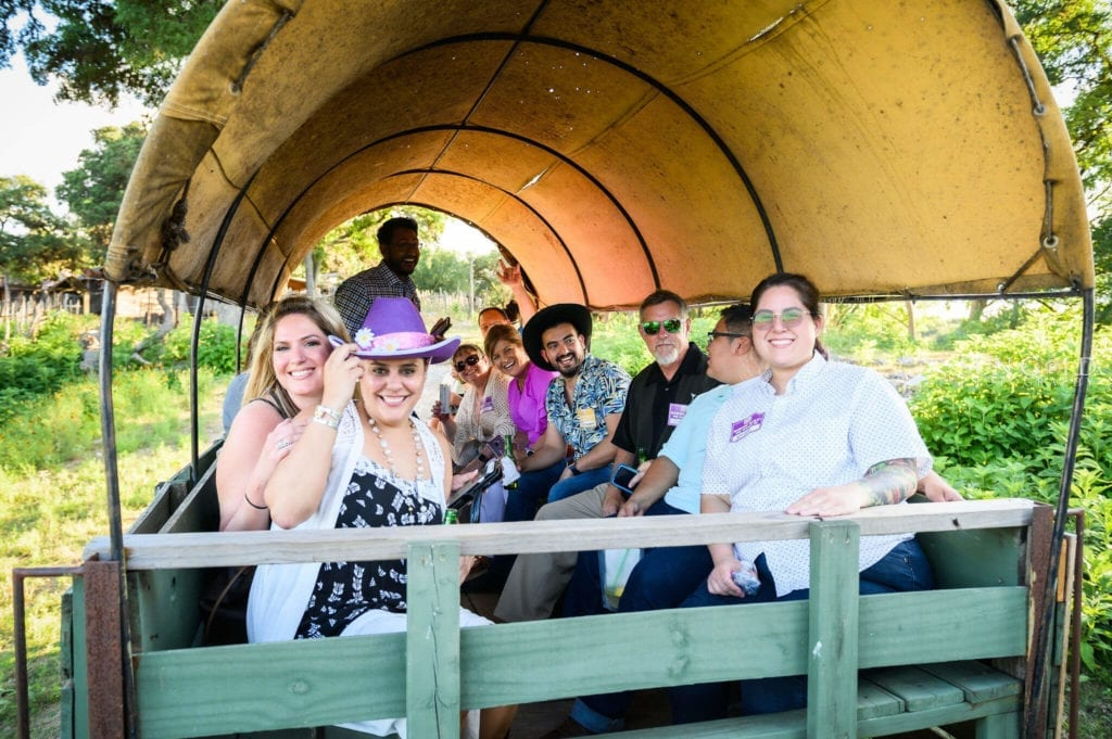 Corporate group enjoying wagon rides at Enchanted Springs Ranch! Photo courtesy of Sun Gold Photography.