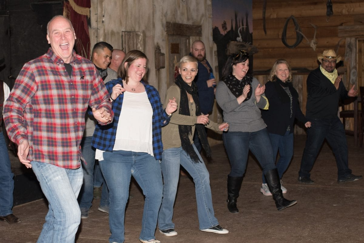 Guests enjoying Texas two step instruction at Enchanted Springs Ranch