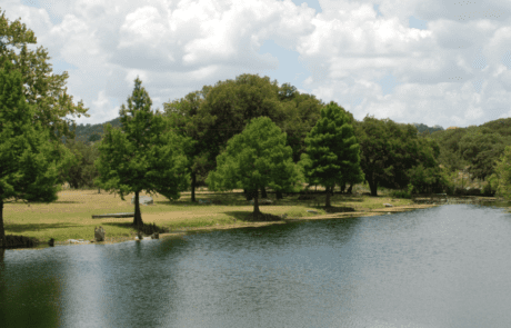 Enchanted Springs Ranch is the perfect location for a corporate event, private event or a team building retreat. Pictured is the beautiful lake on the ranch. It's a wonderful location for your wedding ceremony.