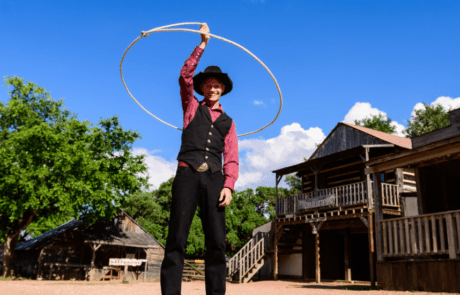 Enchanted Springs Ranch is the perfect location for a corporate event, private event or a team building retreat. Our trick roper performing his show in the old west town.