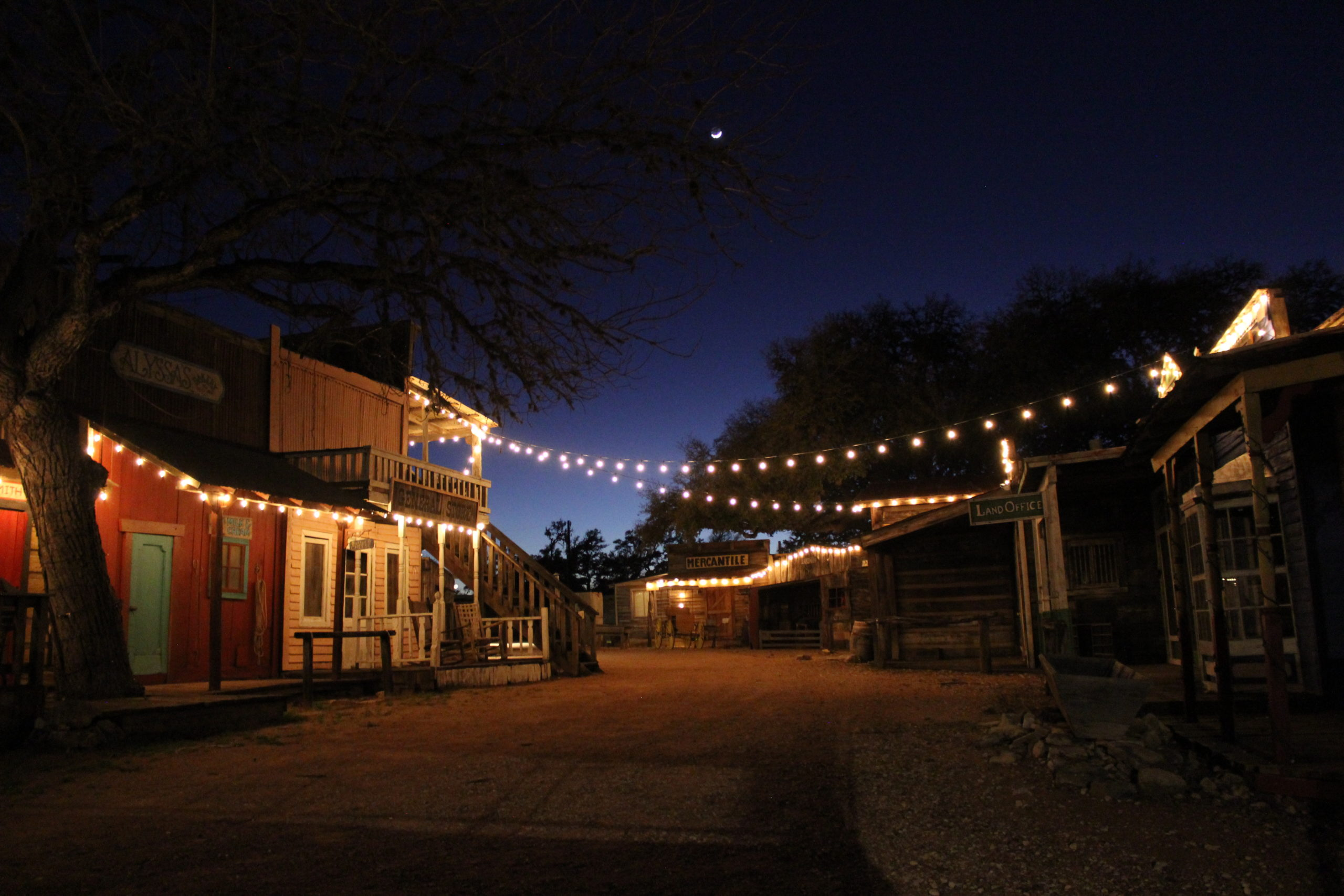 The Old West town at Enchanted Springs Ranch lit up at night